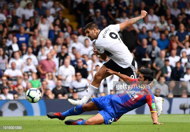 James Tomkins of Crystal Palace tackles Aleksandar Mitrovic of Fulham as he shoots during the Premier League match between Fulham FC and Crystal...