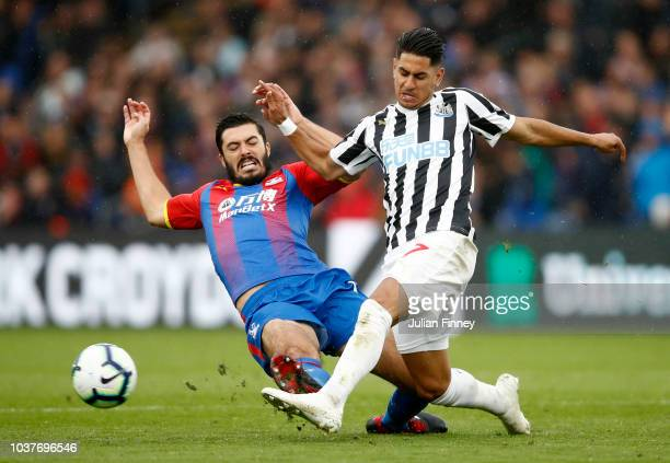 James Tomkins of Crystal Palace tackles Ayoze Perez of Newcastle United during the Premier League match between Crystal Palace and Newcastle United...