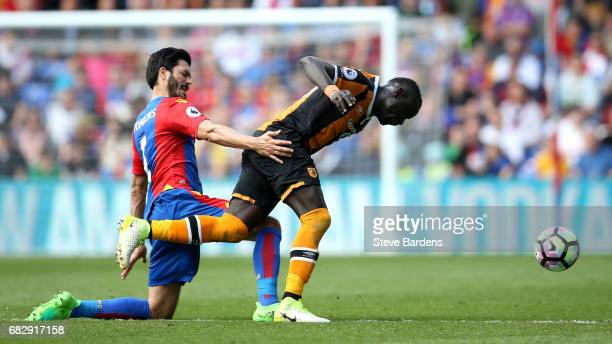 James Tomkins of Crystal Palace tackles Oumar Niasse of Hull City during the Premier League match between Crystal Palace and Hull City at Selhurst...