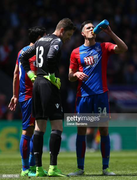 James Tomkins of Crystal Palace Wayne Hennessey of Crystal Palace and Martin Kelly of Crystal Palace speak during the Premier League match between...