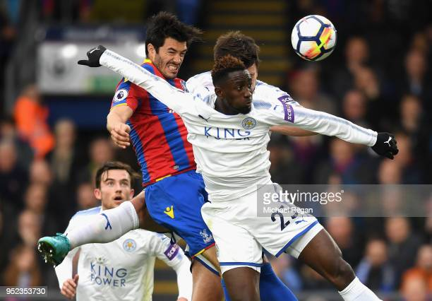 James Tomkins of Crystal Palace wins a header over Wilfred Ndidi of Leicester City during the Premier League match between Crystal Palace and...