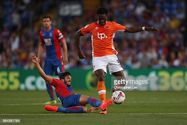 James Tomkins of Palace tackles Armand Gnondvillet of Blackpool during the EFL Cup Second Round match between Crystal Palace and Blackpool at...