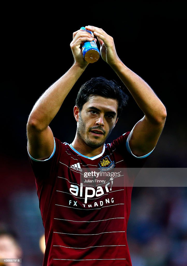 James Tomkins of West Ham applauds the fans after the Barclays Premier League match between West Ham United and Queens Park Rangers at Boleyn Ground on October 5, 2014 in London, England.