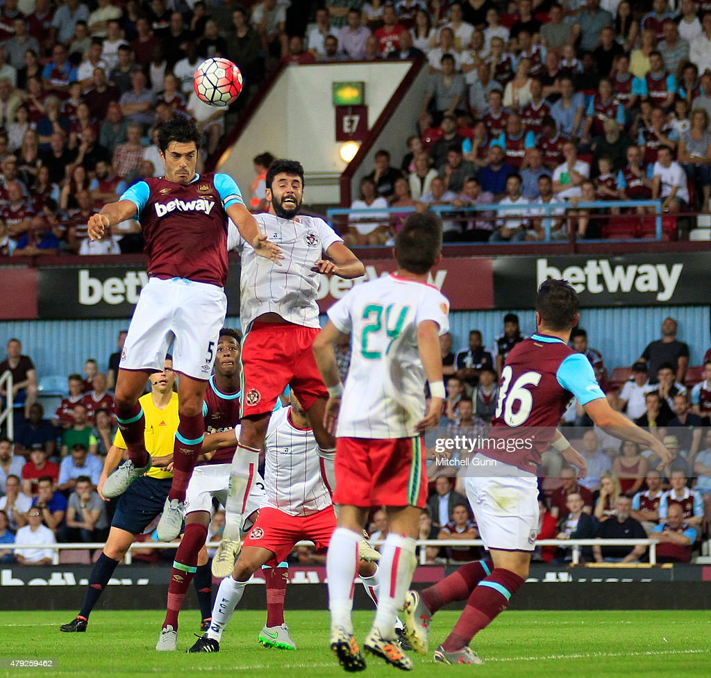 James Tomkins of West Ham heads the ball during the UEFA Europa League match between West Ham United and FC Lusitans at Boleyn Ground on July 2, 2015 in London, England.