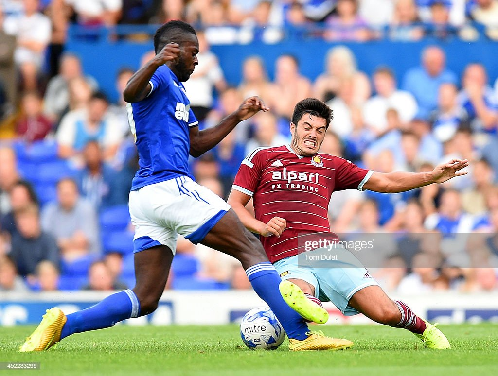 James Tomkins of West Ham United and Frank Nouble of Ipswich Town in action during the pre-season friendly match between Ipswich Town and West Ham United at Portman Road on July 16, 2014 in Ipswich, England.