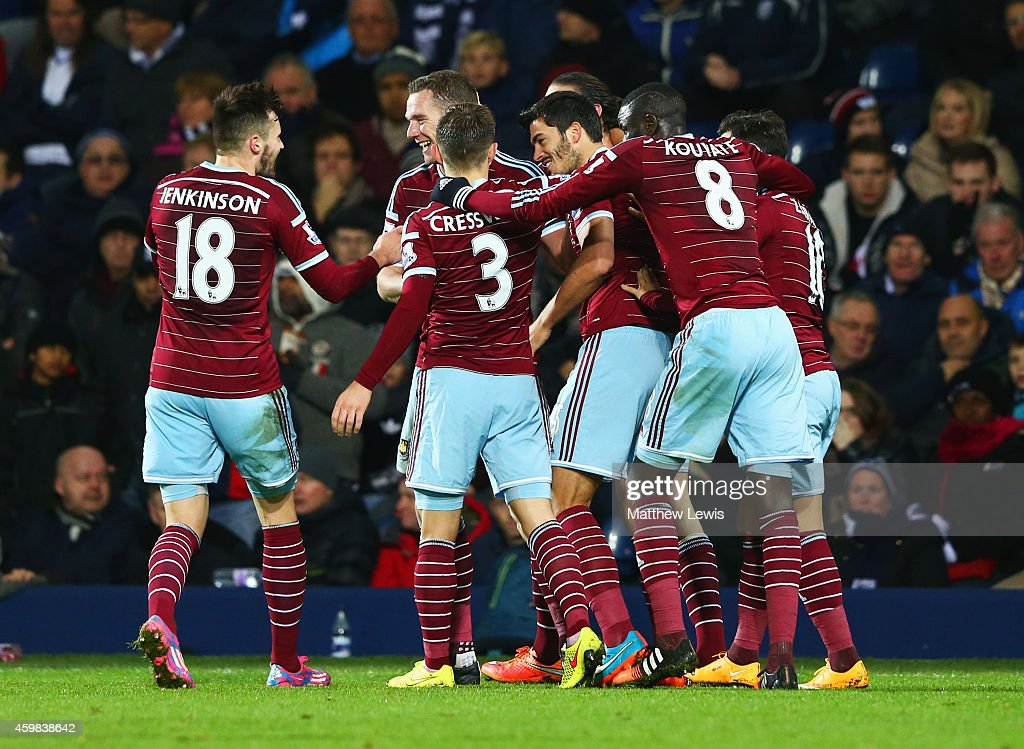 James Tomkins of West Ham United (3R) celebrates with team mates as he scores their second goal during the Barclays Premier League match between West Bromwich Albion and West Ham United at The Hawthorns on December 2, 2014 in West Bromwich, England.
