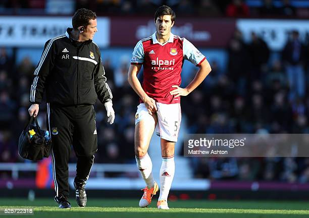 James Tomkins of West Ham United comes off injured with a groin injury