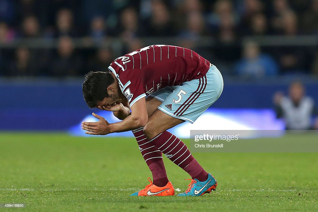 James Tomkins of West Ham United holds his face after clashing with Kevin Mirallas of Everton during the Barclays Premier League match between Everton and West Ham United at Goodison Park on November 22, 2014 in Liverpool, England.
