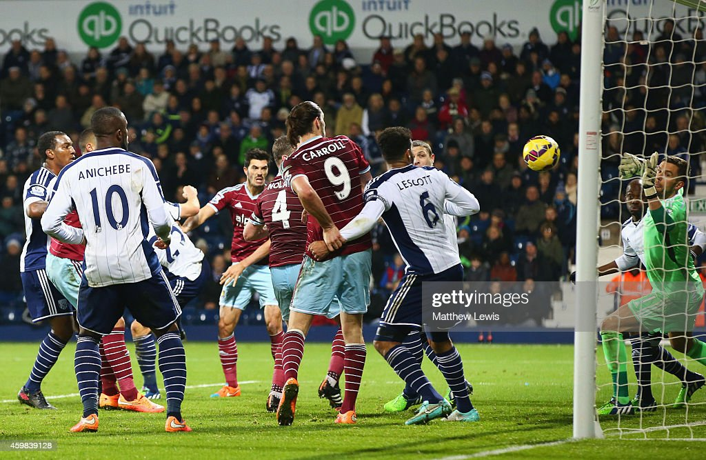 James Tomkins of West Ham United (obscured centre) scores their second goal during the Barclays Premier League match between West Bromwich Albion and West Ham United at The Hawthorns on December 2, 2014 in West Bromwich, England.