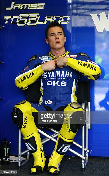 James Toseland of Great Britain and Tech 3 Yamaha gets ready in the team garage during the practice session prior to qualifying for the MotoGP of...