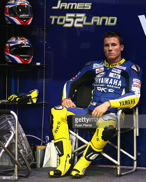 James Toseland of Great Britain and Tech 3 Yamaha Team looks on from the pits during practice for the Motorcycle Grand Prix of Qatar round one of the...