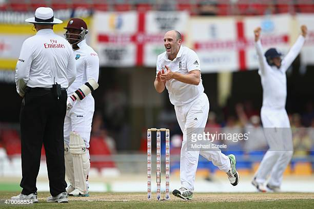 James Tredwell of England celebrates capturing the wicket of Devon Smith of West Indies during day five of the 1st Test match between West Indies and...