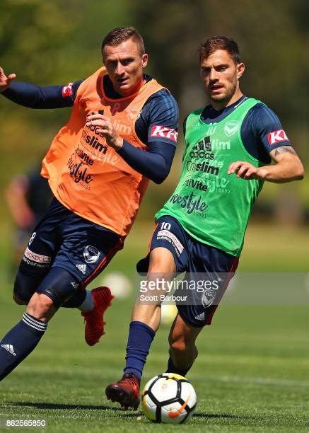 James Troisi and Besart Berisha of the Victory compete for the ball during a Melbourne Victory ALeague training session at Gosch's Paddock on October...