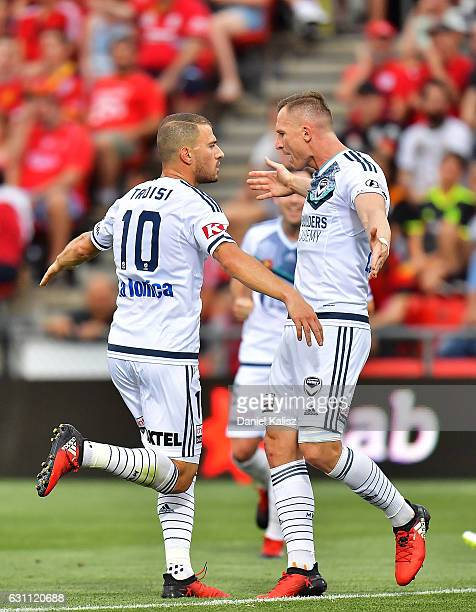 James Troisi and Besart Berisha of the Victory react after scoring during the round 14 ALeague match between Adelaide United and Melbourne Victory at...