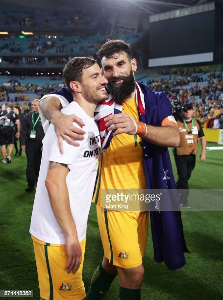 James Troisi and Mile Jedinak of Australia celebrate victory after the 2018 FIFA World Cup Qualifiers Leg 2 match between the Australian Socceroos...