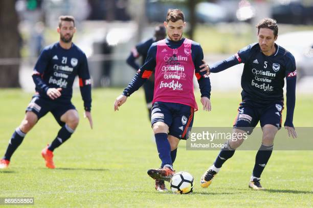 James Troisi controls the ball from Mark Milligan during a Melbourne Victory ALeague training session at Gosch's Paddock on November 3 2017 in...