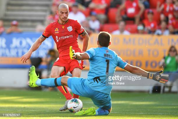 James Troisi of Adelaide United scores his teams second goal past Glen Moss goalkeeper of Newcastle Jets during the round nine A-League match between...