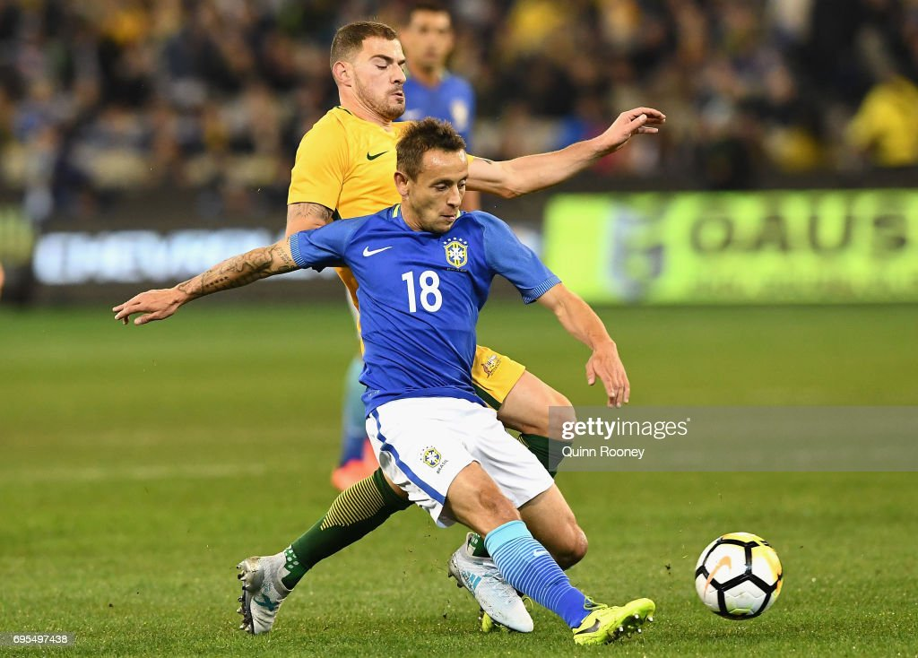 James Troisi of Australia and Marcio Rafael Souza of Brazil compete for the ball during the Brazil Global Tour match between Australian Socceroos and Brazil at Melbourne Cricket Ground on June 13, 2017 in Melbourne, Australia.