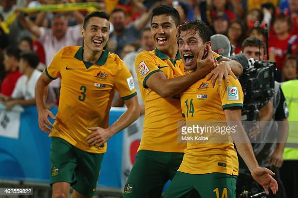 James Troisi of Australia celebrates with his team mates after scoring a goal during the 2015 Asian Cup final match between Korea Republic and the...