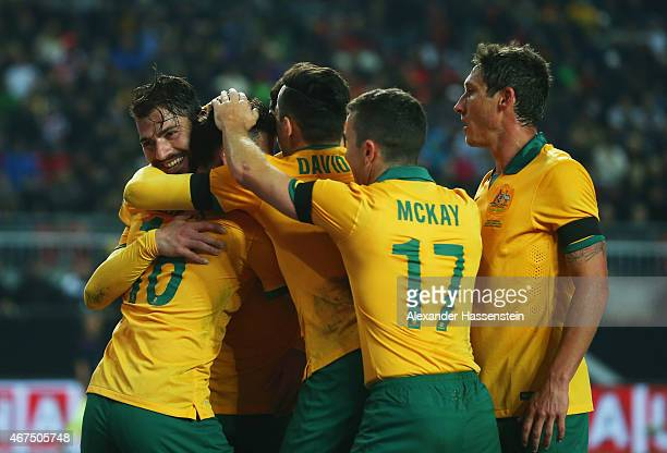 James Troisi of Australia celebrates with team mates as he scores their first and equalising goal during the international friendly match between...