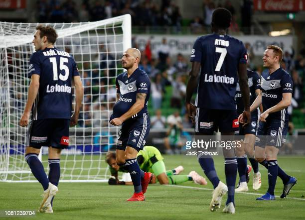 James Troisi of Melbourne Victory celebrates after scoring his team's second goal during the round 13 ALeague match between the Melbourne Victory and...