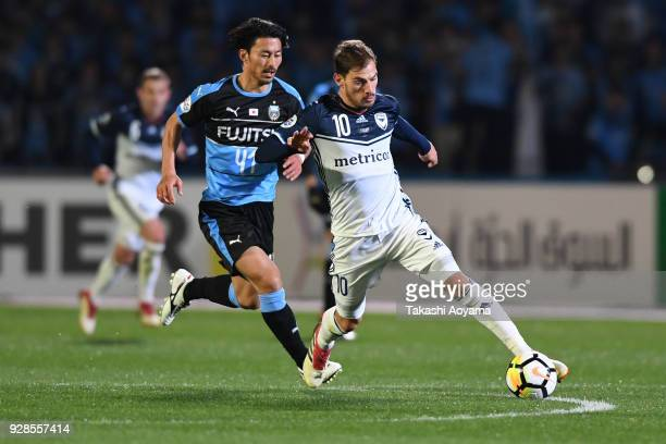 James Troisi of Melbourne Victory controls the ball under pressure of Akihiro Ienaga of Kawasaki Frontale during the AFC Champions League Group F...