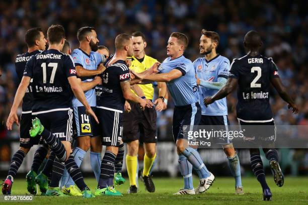 James Troisi of Melbourne Victory scuffles with Brandon O'Neill of Sydney FC during the 2017 ALeague Grand Final match between Sydney FC and the...