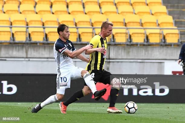 James Troisi of Melbourne Victory tackles Goran Paracki of the Wellington Phoenix during the round nine ALeague match between the Wellington Phoenix...