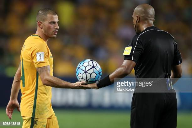 James Troisi of the Socceroos hands the ball to referee Ahmed Abu Al Kaf during the 2018 FIFA World Cup Qualifier match between the Australian...