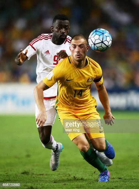 James Troisi of the Socceroos is challenged by Ahmed Barman of the United Arab Emirates during the 2018 FIFA World Cup Qualifier match between the...