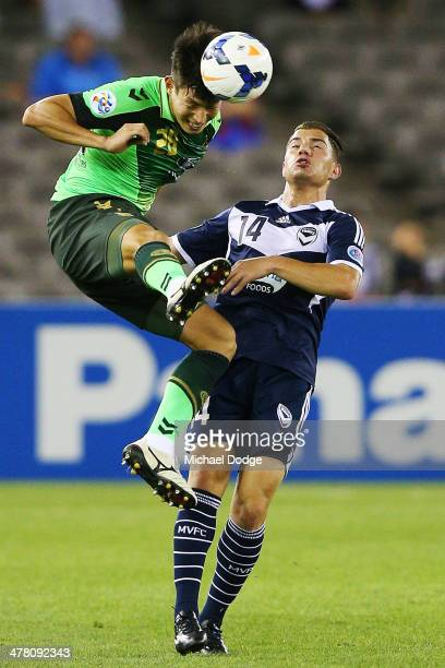 James Troisi of the Victory and Lee Gang Jin of Joenbuk contest for the ball during the AFC Asian Champions League match between the Melbourne...