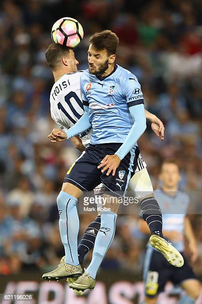 James Troisi of the Victory and Michael Zullo of Sydney FC compete for the ball in the air during the round five ALeague match between Sydney FC and...