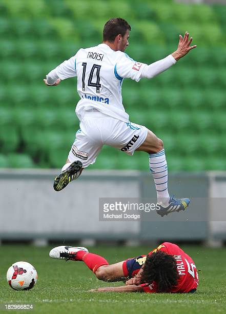 James Troisi of the Victory and Osama Malik of United contest for the ball during the A-League pre-season match between the Melbourne Victory and...