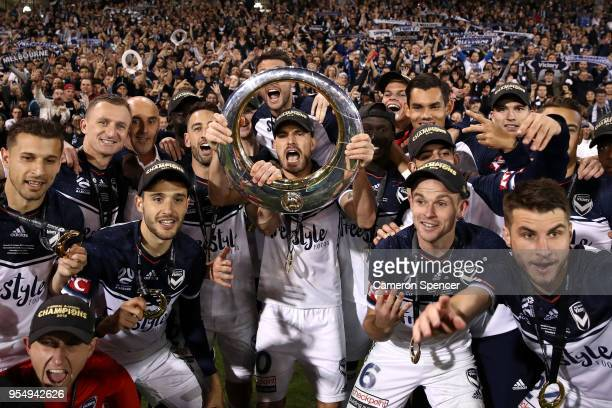 James Troisi of the Victory and team mates celebrate winning the 2018 ALeague Grand Final match between the Newcastle Jets and the Melbourne Victory...
