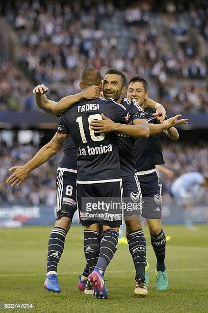 James Troisi of the Victory celebrates a goal with team mates during the round 17 ALeague match between the Melbourne Victory and Sydney FC at Etihad...