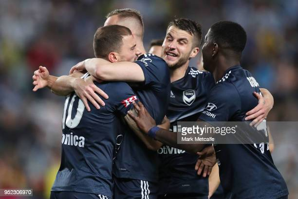 James Troisi of the Victory celebrates scoring a goal with team mates during the A-League Semi Final match between Sydney FC and Melbourne Victory at...