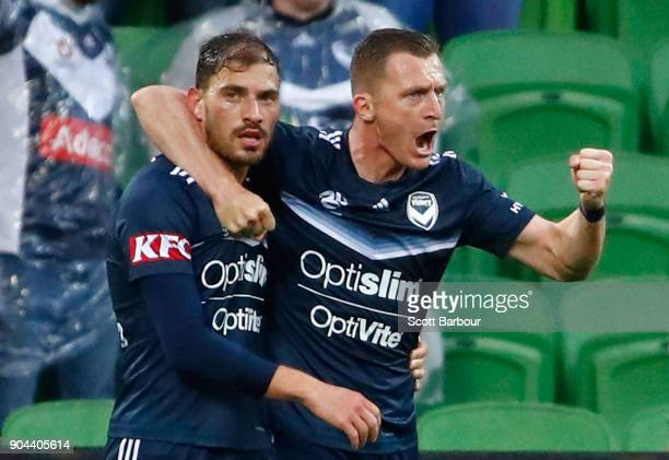 James Troisi of the Victory celebrates with Besart Berisha after scoring his sides first goal during the round 16 ALeague match between the Melbourne...