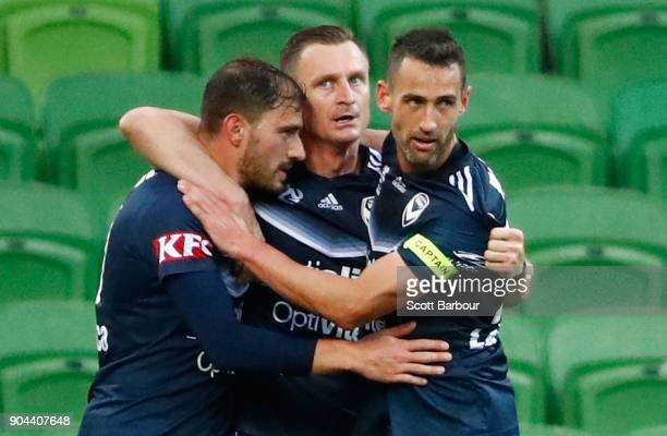 James Troisi of the Victory celebrates with Besart Berisha and Carl Valeri after scoring his sides first goal during the round 16 ALeague match...