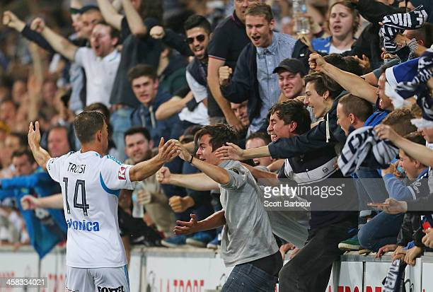 James Troisi of the Victory celebrates with supporters after scoring a goal during the round 11 ALeague match between Melbourne Heart and Melbourne...