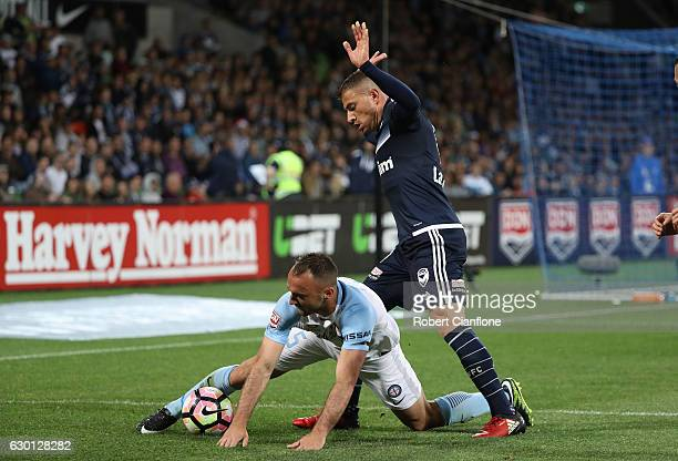 James Troisi of the Victory challenges Ivan Franjic of Melbourne City during the round 11 ALeague match between Melbourne City FC and Melbourne...