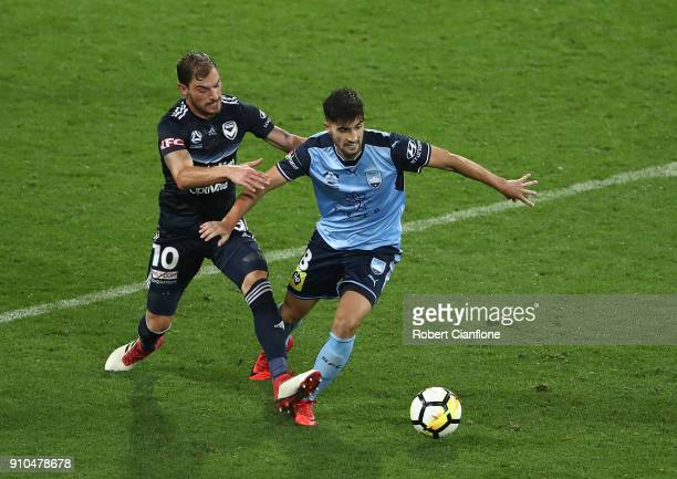 James Troisi of the Victory challenges Paulo Retre of Sydney FC during the round 18 ALeague match between Melbourne Victory and Sydney FC at AAMI...