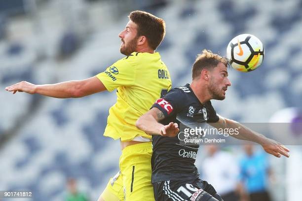 James Troisi of the Victory competes in the air during the round 14 ALeague match between the Melbourne Victory and the Central Coast Mariners at...