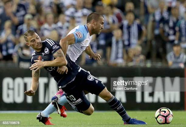 James Troisi of the Victory is challenged by Manny Muscat of Melbourne City during the round 18 ALeague match between Melbourne Victory and Melbourne...
