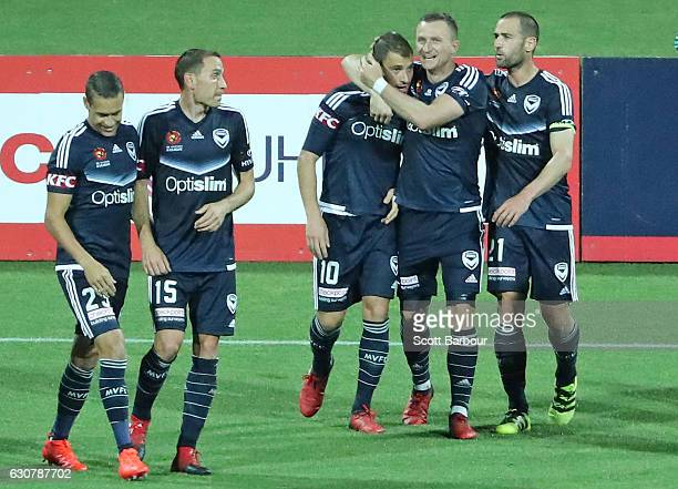 James Troisi of the Victory is congratulated by Besart Berisha and his teammates after scoring a goal during the round 13 ALeague match between...