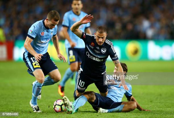 James Troisi of the Victory is tackled by Joshua Brilliante of Sydney FC during the 2017 ALeague Grand Final match between Sydney FC and the...