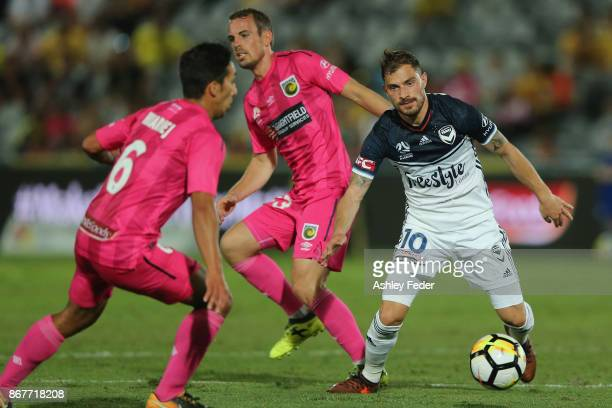 James Troisi of the Victory is tackled by the Mariners defence during the round four ALeague match between the Central Coast Mariners and the...