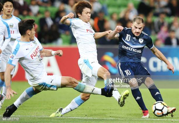 James Troisi of the Victory kicks the ball past Eduardo of Kawasaki Frontale during the AFC Asian Champions League match between the Melbourne...