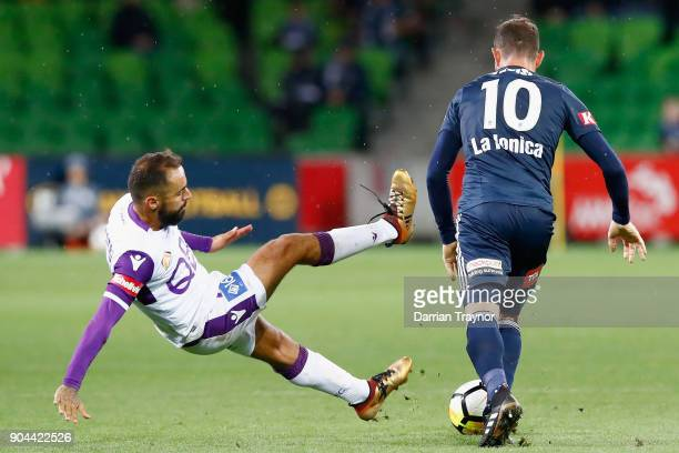 James Troisi of the Victory pushes Diego Castro of Perth Glory off the ball during the round 16 ALeague match between the Melbourne Victory and Perth...