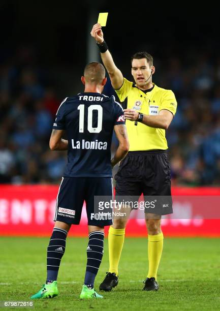 James Troisi of the Victory receives a yellow card during the 2017 ALeague Grand Final match between Sydney FC and the Melbourne Victory at Allianz...