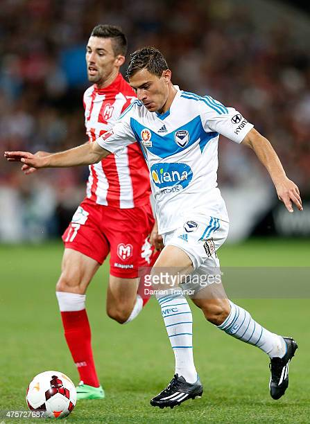 James Troisi of the Victory runsl with the ball during the round 21 A-League match between Melbourne Heart and Melbourne Victory at AAMI Park on...